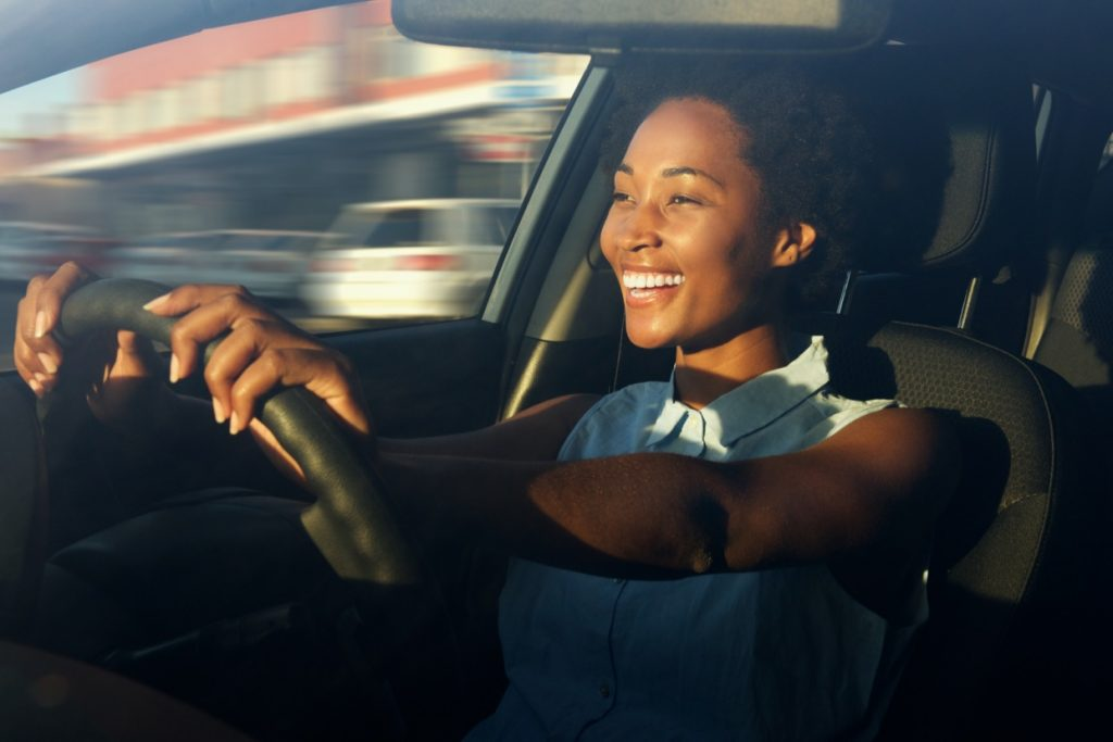 woman happy driving