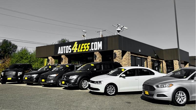 Autos4Less car dealership building
